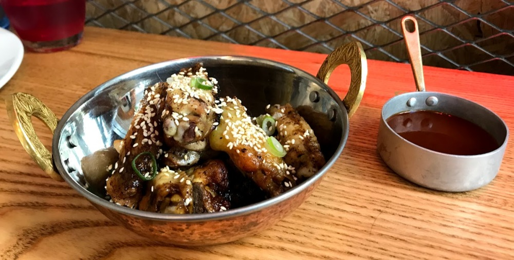 a pluma- pollo al ast gourmet Santaló-alitas